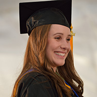 Photo of a graduate smiling